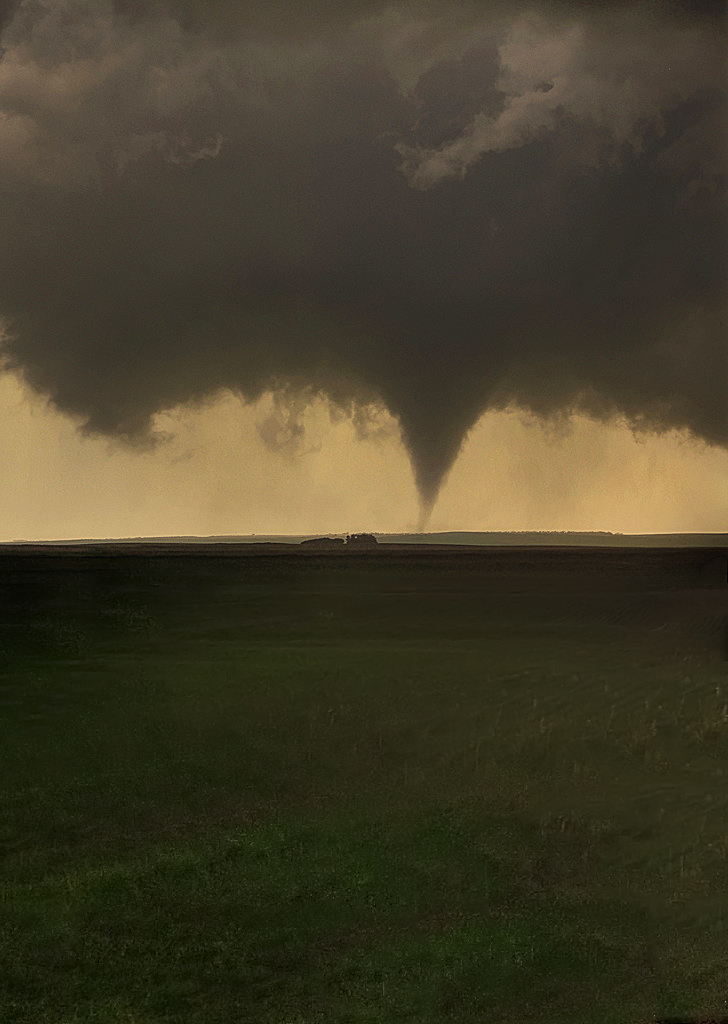 canada tornado alberta lawnmowing man defies twister